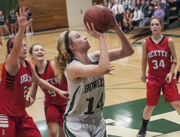 Penobscot Valley High School girls basketball player Sami Ireland (14) pushes to the hoop past Dexter players Lauren Crane (22), Jordyn Bell (5) and Michaela White in the final minutes of their game in Howland on Saturday. Dexter won 50-41.