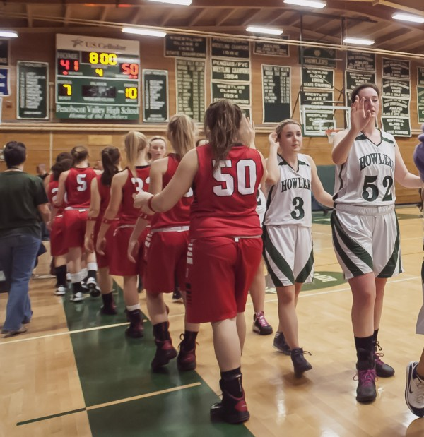 The Dexter and Penobscot Valley girls basketball teams go through their postgame sportsmanship  congratulations Saturday after Dexter defeated PVHS 50-41 in Howland on Saturday.