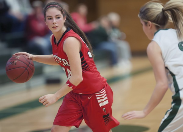 Dexter girls basketball player Michaela White (34) looks for an opportunity to advance past Penobscot Valley's Kassy Taylor (3) in the first half of their girls basketball game in Howland on Saturday. Dexter won 50-41.
