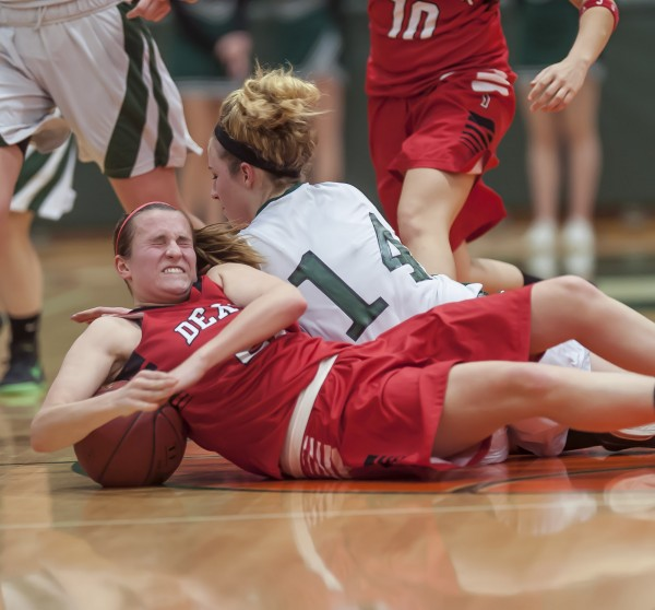 Dexter girls basketball player Lauren Crane (front) scrambles for a loose ball on the floor with Penobscot Valley's Sami Ireland (14) in the first half of their basketball game in Howland on Saturday. Dexter won 50-41.