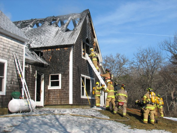 Firefighters try to extinguish a morning blaze at a home off Route 3 in Trenton on Tuesday, Jan. 29, 2013.