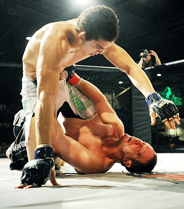 John Raio of Topsham (right) flips Ray Wood of Bangor off of him during their professional debuts in a mixed martial arts bout last November in Lewiston. Wood won the bout by TKO in the second round. New England Fights has put an emphasis on featuring local talent for its fight cards.
