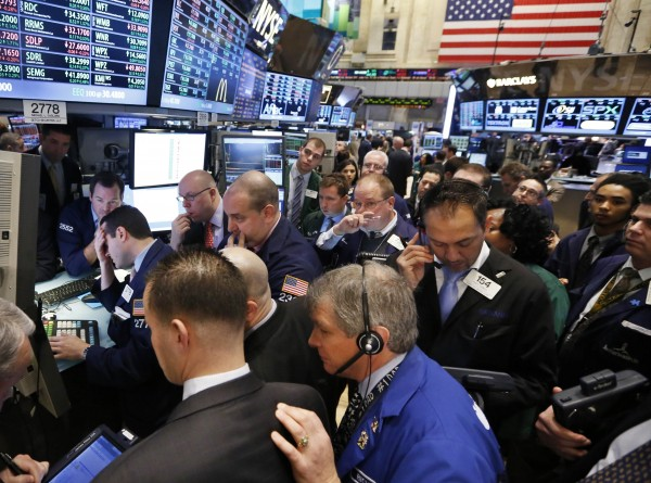 Traders work on the floor of the New York Stock Exchange, Jan. 18, 2013.