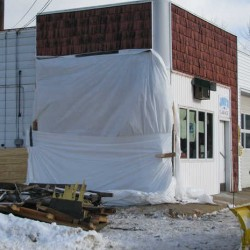 On Wednesday morning, Jan. 2, 2013, white sheets of plastic wrap covered the office wall at Jake's Garage at 529 Prospect Ave. in Rumford. The wall was destroyed early New Year's Day when a drunk driver in a pickup truck slammed into the building, then left the scene, according to Rumford police officer Donald Miller's report.