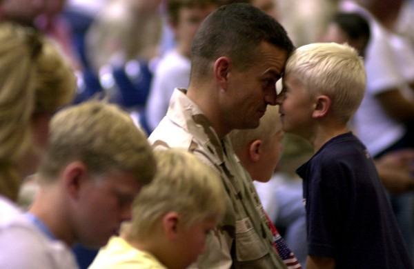 Lt. Col. Michael Backus, seen here as a major, and his son Evan Backus, 6, are surrounded by family as they play together during the Maine Army National Guard's Freedom Salute for Operations Iraqi Freedom and Enduring Freedom, at the Bangor Auditorium in 2004. Backus died in Augusta on Monday, Jan. 7, 2013.