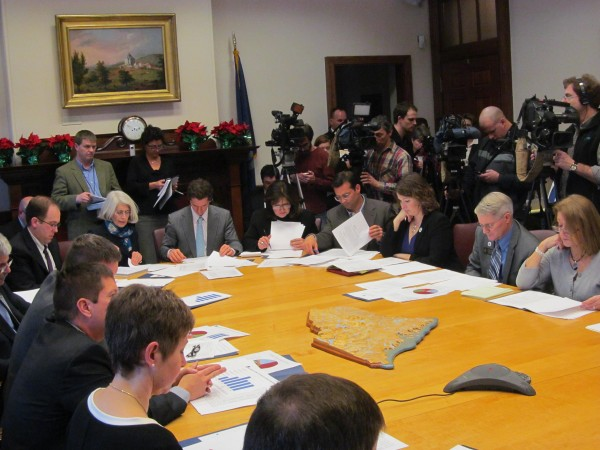 Members of the Legislature study budget documents provided by Gov. Paul LePage's administration on Friday, Jan. 11, 2013, during the unveiling of LePage's $6.3 billion biennial budget in Augusta.