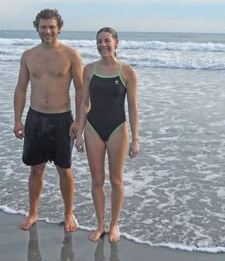 Justin Satera of South Salem, N.Y., and Marie Richey of York swam Monday, Jan. 14, 2013, at Long Sands Beach in York.