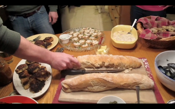 Guests at a dinner party in Winterport last weekend sample foods from Quebec.