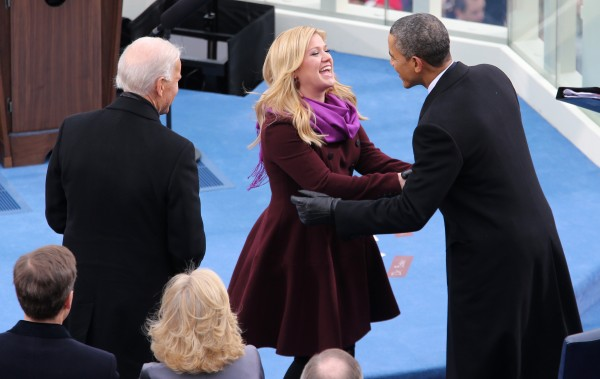 President Barack Obama greets singer Kelly Clarkson during inauguration ceremonies for Obama's second inauguration at the West Front of the Capitol in Washington, D.C., on Monday, Jan. 21, 2013.