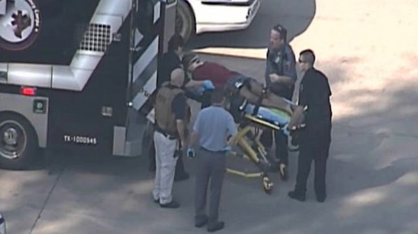 Police and emergency personnel evacuate an injured male on a stretcher on the Lone Star College Campus near Houston, Texas, in this still image taken from video courtesy of KPRC-TV Houston on Tuesday, Jan. 22, 2013. Multiple people have been shot according to news reports.