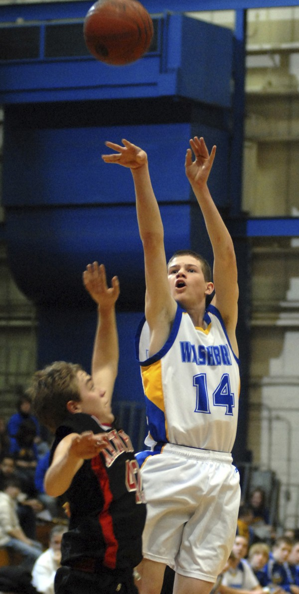 Washburn's Mitchell Worcester launches a shot over a Katahdin defender during an Eastern Maine Class D tourney game in February 2011. Worcester scored 39 points in a 69-61 win over Fort Fairfield Tuesday night and now has a career 2,020 points.
