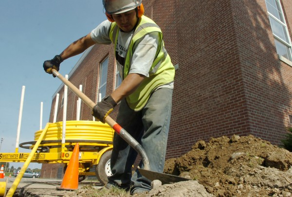 Natale Acosta of Northern Pipeline works outside of Bangor's William S. Cohen School in September 2008.