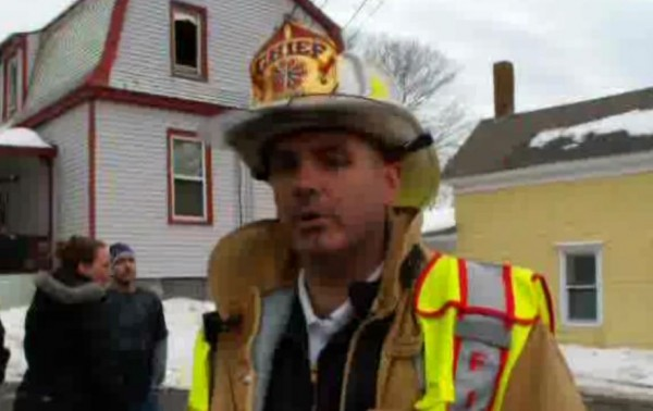 Brunswick Fire Chief Ken Brillant fields questions from a reporter at the scene of an Oak Street blaze Friday afternoon in this screen shot of a video posted on The Times Record website, www.timesrecord.com.