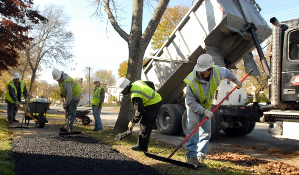 Gardner Construction Enterprises employees Tim McQuarrie, Dennis Jones, Kyle Baker, Tim McQuarrie Jr, and Steve McDougall (right to left) repair areas of sidewalk on West Broadway in Bangor in November 2011.
