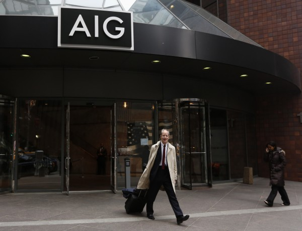 A man exits AIG headquarters in New York's financial district Wednesday, Jan. 9, 2013. The board of American International Group Inc. decided on Wednesday not to join a lawsuit against the U.S. government over the terms of the company's bailout, following two days of fevered backlash from Congress and the public.