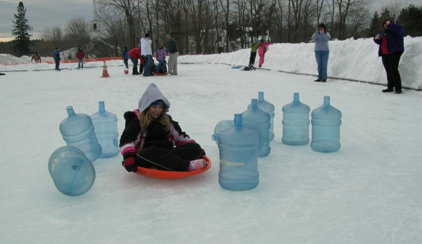 Mikayla Fishburn, 8, of Mariaville spins into empty water-cooler bottles set up as bowling pins during the Human Bowling event at the 2011 Ellsworth Winter Carnival.