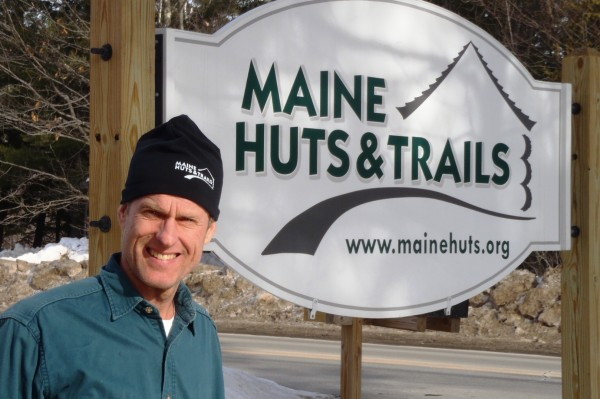 Charlie Woodworth, a resident of both Yarmouth and Carrabassett Valley, stands beside the Maine Huts & Trails sign after being appointed execute director of the nonprofit organization, announced on Jan. 15, 2013.
