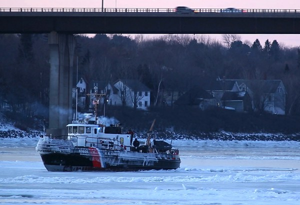 The U.S. Coast Guard ice cutter is surrounded by ice in the Penobscot River on Wednesday morning in Bangor. Temperatures dropped nearly 50 degrees from over the weekend, and according to the National Weather Service, will remain in the single digits until Friday.