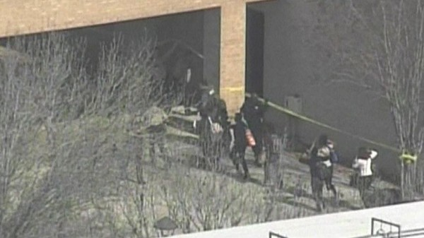 People run from a building on the Lone Star College campus near Houston, Texas, in this still image taken from video courtesy of KPRC-TV Houston, on Jan. 22, 2013. Three people have been shot, according to news reports.