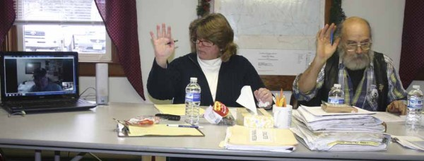 Sangerville Selectmen Melissa Randall and Tom Carone vote on Dec. 28 to allow Irving McNaughton to participate by Internet during last week's board meeting. McNaughton seen in the computer screen on the left is spending several weeks in Florida and requested to participate in selectmen's meeting via Skype until he returns in March.