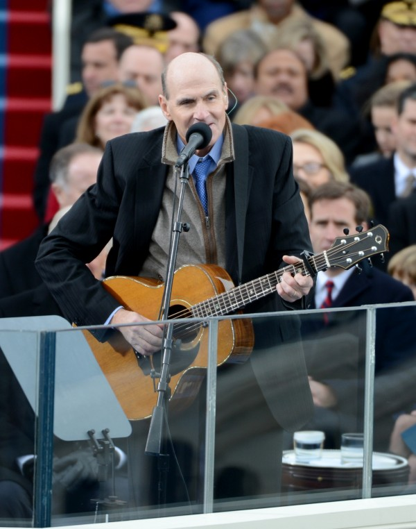 Musician James Taylor sings before President Barack Obama is sworn-in for a second term at the Capitol in Washington, D.C., on Monday, Jan. 21, 2013.
