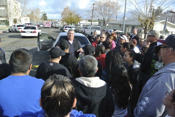 Taft Police Chief Ed Whiting speaks to concerned parents after a shooting at Taft Union High School in Taft, Calif., on Jan. 10, 2013. Gunfire erupted on Thursday at the school. Two people were injured, county officials said, and media reports indicated the assailant had been arrested.