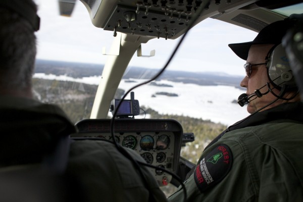 From left,  Lee Kantar, a wildlife biologist for the Maine Department of Inland Fisheries and Wildlife, and pilot Chris Blackie performed a moose survey by helicopter over Maine's Wildlife Management District 19 on Tuesday morning, Jan. 29, 2013.