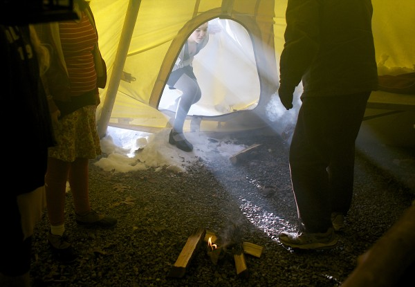 Zhenya Winters, 14, enters her family's teepee Wednesday, Jan. 23, 2013, where her parents Jim and Laura Winters have slept nearly every night for the last three and a half years at their home in Orono.