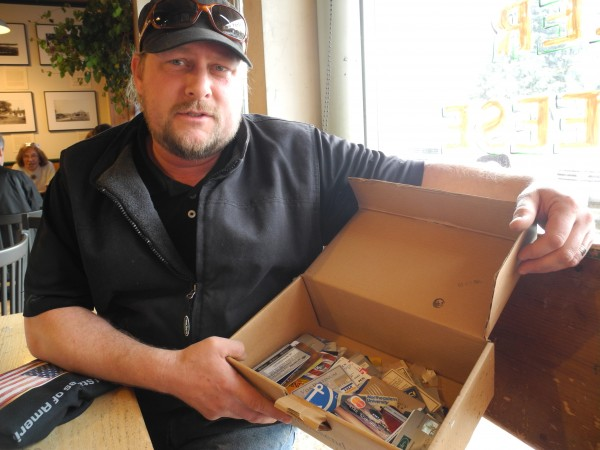 Eric Leppanen displays a shoe box with &quotat least 100&quot expired credit cards that he had obtained during a long career with MBNA and Bank of America. After being laid off and then declaring bankruptcy, the Belfast house cleaner and artist is hoping that his experiences can help others stay out of credit card debt.