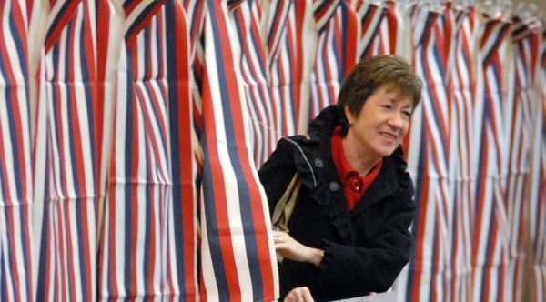 U.S. Sen. Susan Collins, R-Maine, steps out of a booth at the Bangor Civic Center where she voted on Election Day 2012.