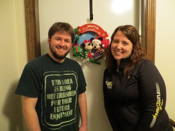 Zach Meehan and Morgan McCluskey stand outside the door of their apartment.  They have embraced everything Disney, including the motivation to get in shape and compete in  the Walt Disney World Marathon Weekend on Jan. 12, 2013.
