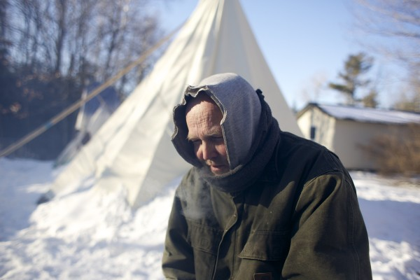James Winters stands in front of the teepee that he and his wife Laura have slept in nearly every night for the last three and a half years to reconnect with nature at their home in Orono. Winters hopes to move the teepee farther into the woods on their property from its current location in his front yard.