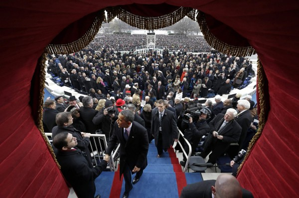 President Barack Obama greets people as he exits following the ceremonial swearing-in at the presidential inauguration on the West Front of the U.S. Capitol in Washington, D.C., on Monday, Jan. 21, 2013.