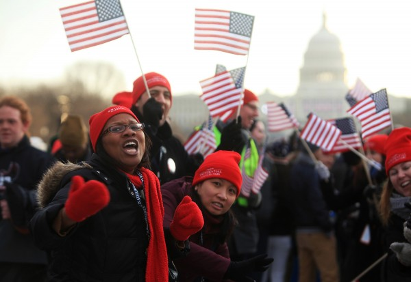 Dr. Jessie K. Kimbrough-Sugick, of Ann Arbor, Mich., encouraged spectators as they arrive on the National Mall for the inauguration ceremonies Monday, Ja. 21, 2013, in Washington, D.C.