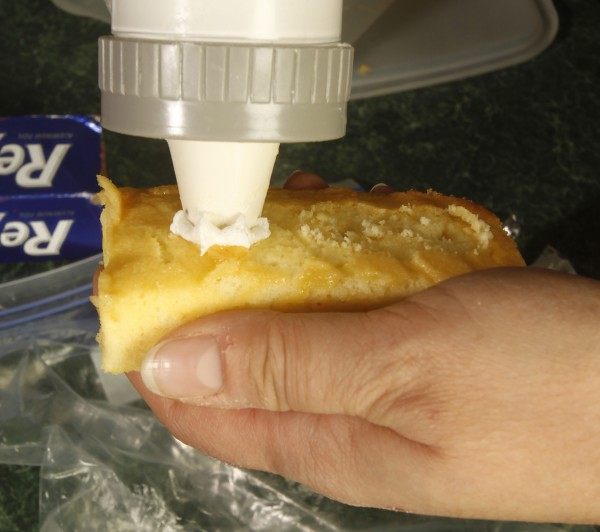 Fill the inside of a homemade Twinkie with cream.