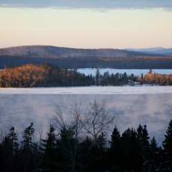 Recovery efforts for missing snowmobilers remain on hold at Rangeley Lake