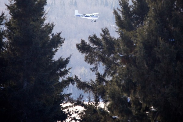 A search plane flies low over Rangeley Lake on Thursday afternoon, Jan. 3, 2013 searching for missing snowmobilers Glenn Henderson, 43, of Sabattus, Kenneth Henderson, 40, of China and John Spencer, 41, of Litchfield.