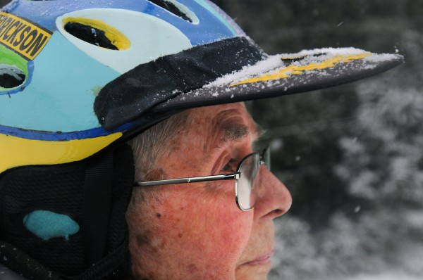 Ed Hendrickson wears a helmet he decorated as he rides the chairlift at Hermon Mountain on Wednesday. The Brewer native goes to ski nearly every day during the season and when there is no snow in the area, he travels north and out of state.