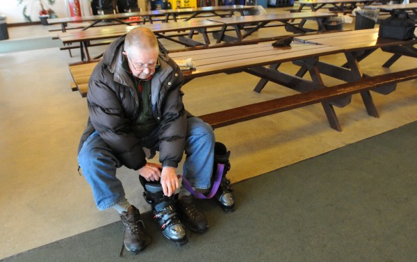 Ed Hendrickson of Brewer gets his ski boots ready at the Hermon Mountain Ski Area on Wednesday. &quotWhen I started skiing again, I was unabe to put my boots on by myself. I started exercising and now I'm able to do so.&quot he said.  Hendrickson is 92-years-old and after a several-decade hiatus, he took up skiing again about six years ago.