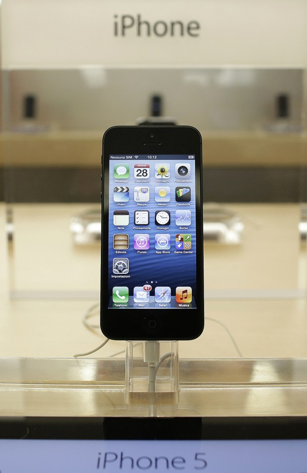 An Apple iPhone 5 is displayed in an Apple store in Rome, in this file picture taken September 28, 2012. Apple's stock dropped 4 percent Wednesday after iPhone sales came in below expectations.