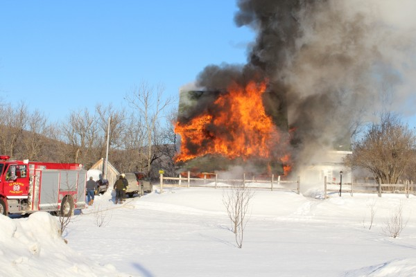 Cold temperatures and wind hampered the fighting of this fire that destroyed the Main Street home of Paul Langenbauch and Cindy Young on Friday morning, Jan. 18, 2013. Two dogs perished in the blaze.