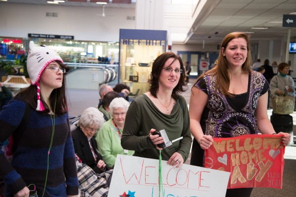 The family of Army Pfc. Caleb Frappier drove from their home in Connecticut to Bangor on Thursday morning, Jan. 10, 2013 to surprise him as he returned from a nine-month tour of duty in Afghanistan. Frappier's sister Faith Frappier (from left), his mother Christine Bell, and fiance Kelly Dixon anxiously awaited Frappier in the Bangor International Airport Terminal. &quotI'm so nervous.&quot said Dixon. &quotI've been to the bathroom nine or 10 times already.&quot