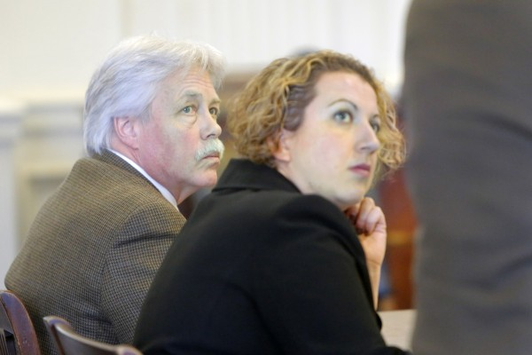 Mark Strong (left) and co-counsel Tina Nadeau listen to Daniel Lilley address Justice Nancy Mills on Tuesday, Jan. 29, 2013 at York County Superior Court in Alfred. Mills denied a motion by Lilley to start the trial on the 13 remaining counts against strong, ordering that the trial be postponed until the Maine Supreme Judicial Court rules on the prosecutors' appeal of the dismissal of 46 charges against Strong.