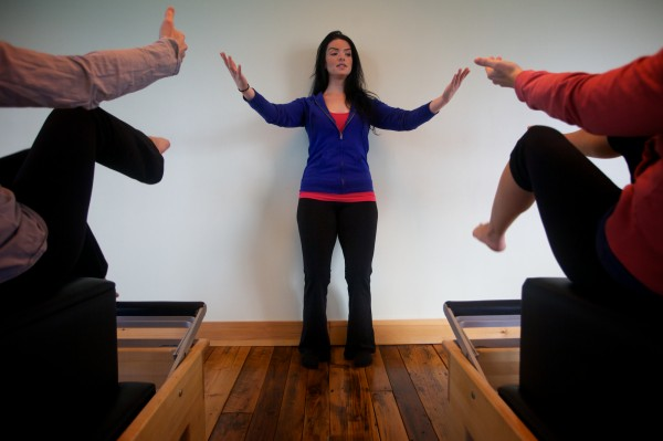 Lacey Vassar, Pilates instructor at Pure Movement Portland, works with a class Tuesday, Jan. 15, 2013.