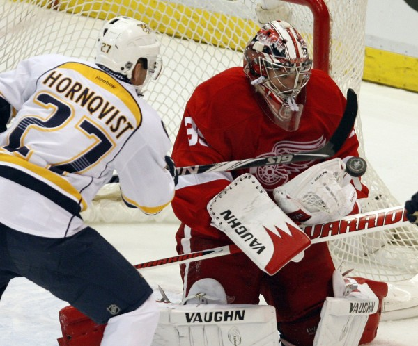 Detroit Red Wings goalie Jimmy Howard makes a save against the Nashville Predators' Patric Hornqvist during a playoff game last April in Detroit. Howard, a former University of Maine star, is eager to begin the NHL season.