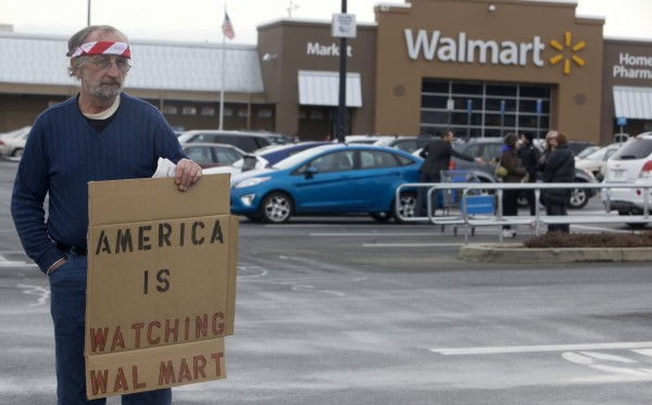 Joseph Barbarito holds a sign as he waits for protesters to deliver a petition to Walmart in Danbury, Conn., on Jan. 15, 2013. The petition was signed by about 300,000 citizens nationwide urging Walmart, the nation's largest gun retailer, to halt sales of assault weapons and munitions nationwide.