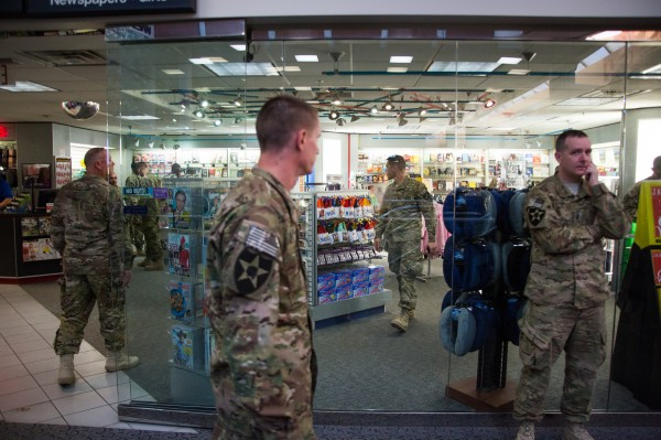 Army troops mull around the Bangor International Airport gift shop during a layover. The troops arrived from Afghanistan and were traveling back to their respective bases.