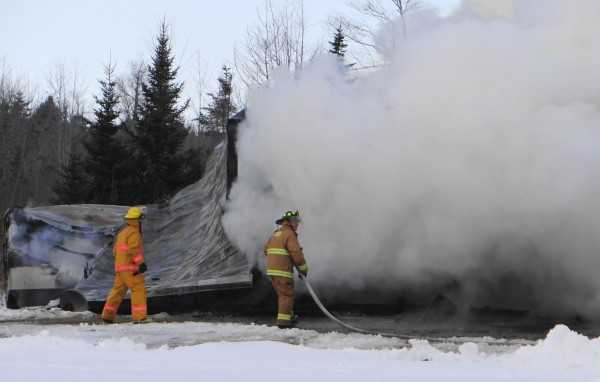 Firefighters were able to contain a blaze that destroyed a garage, saving the adjacent trailer home off Route 1 in Stockton Springs on Friday afternoon, Jan. 4, 2013.