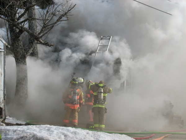 Smoke envelopes a burning house on Route 1 in Sullivan on Thursday, Jan. 24, 2013.
