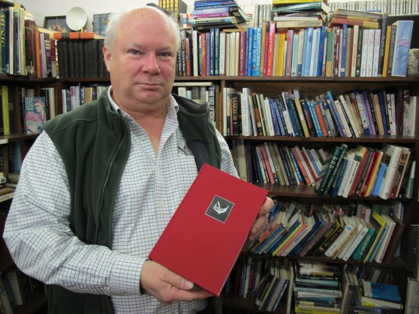 Michael Riggs of Scottie's Bookhouse in Hancock shows off a limited-edition, signed copy of Stephen King's &quotThe Regulators,&quot written in 1996 under a pseudonym. Riggs managed the book's auction, the proceeds of which benefit the Emmaus Homeless Shelter's efforts to keep Mainers warm this winter.